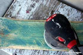 use an electric sander to sand through paint layers