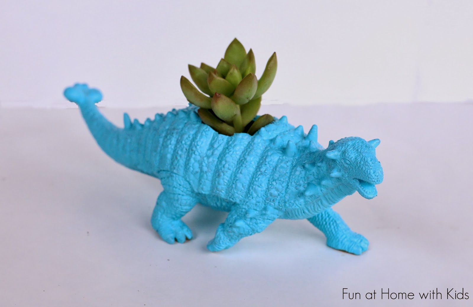 DIY Dinosaur Planters for between three and five dollars!  An easy and fun project - these would make a great gift!  From Fun at Home with Kids