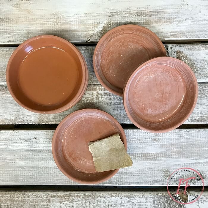 How to repurpose dollar store terracotta flower pot saucers into pretty summer drink coasters with French Country style using floral decor transfers.