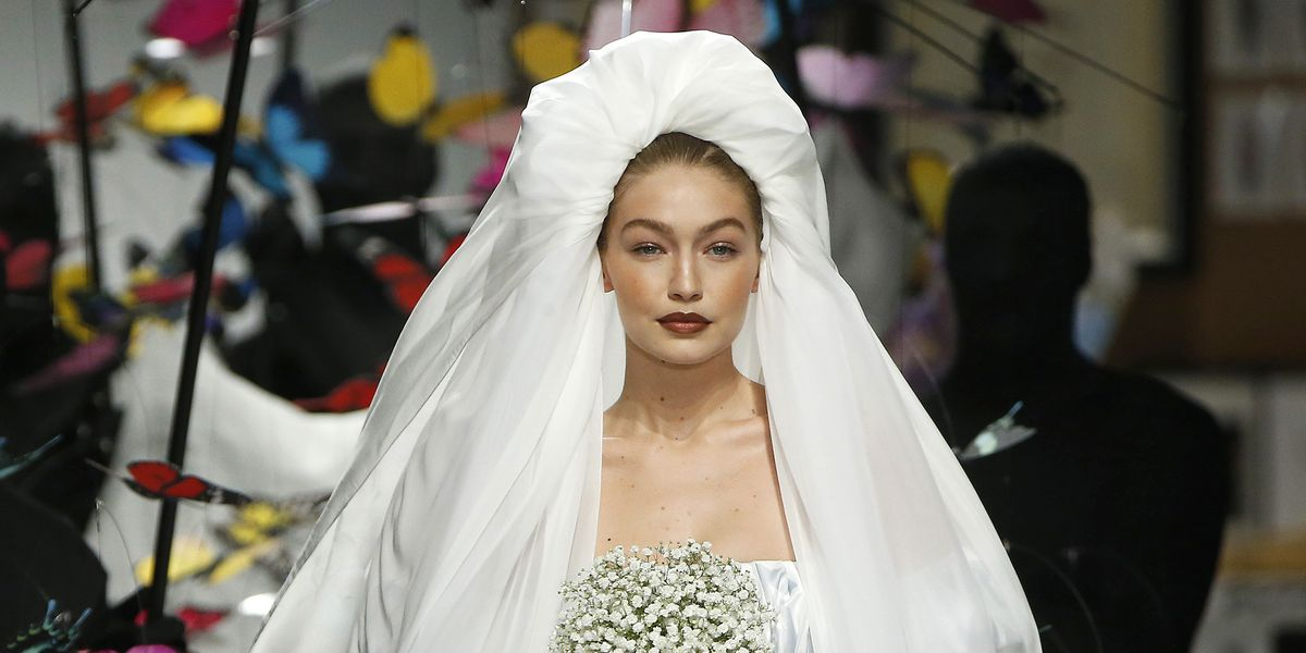Gigi Hadid makes the ultimate Moschino bride on the Milan SS19 Fashion Show Ramp