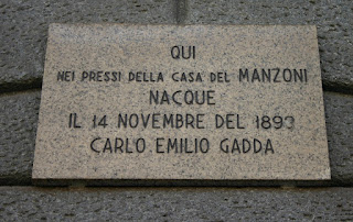 Gadda's birthplace in Milan is marked with a plaque