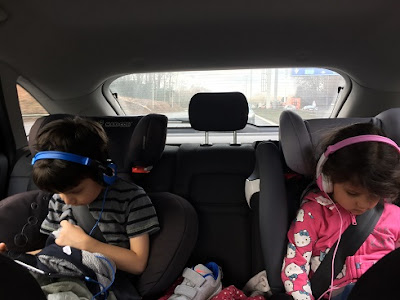 Children on ipads in the car