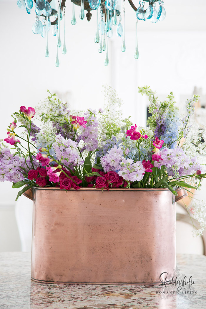 copper pot filled with flowers