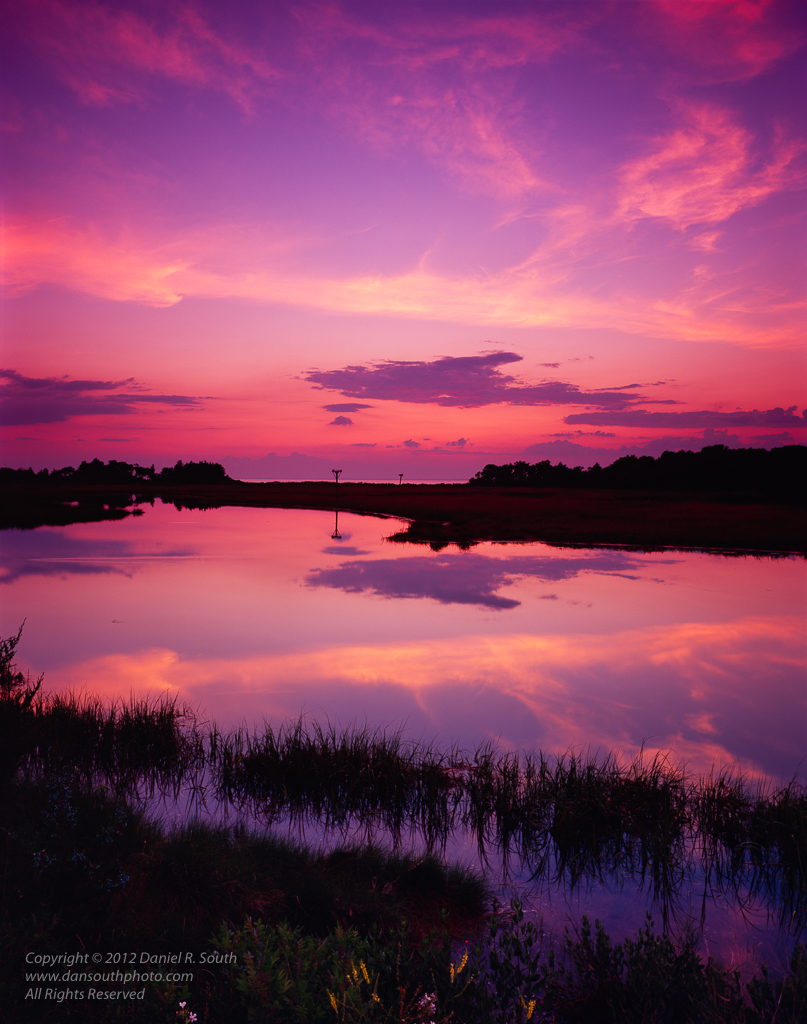 a photo of sunset over marshland at sandy hook new jersey shore