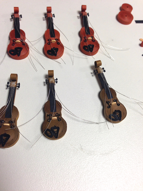 strings placed on quilled violins