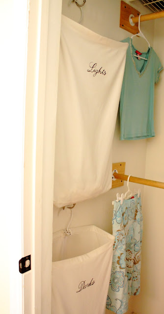 Easy DIY laundry storage system using hanging laundry bags from The Red Chair Blog