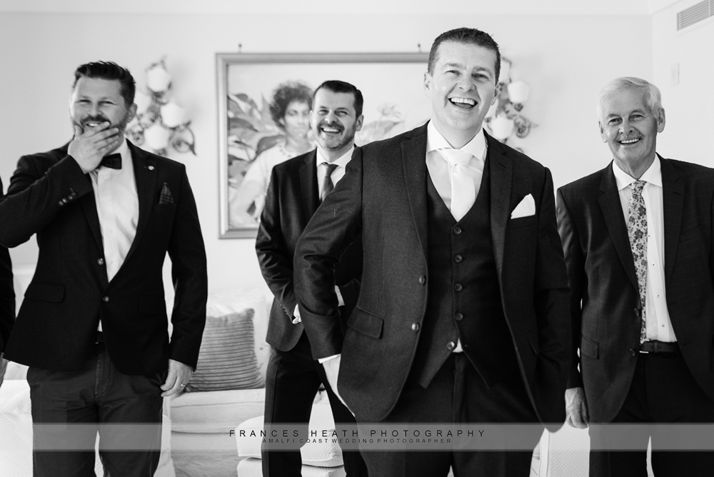 Groom with groomsmen on his wedding day