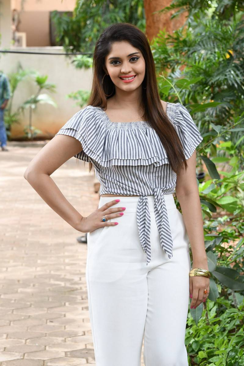 Surabhi Photos Movie Interview In White Top