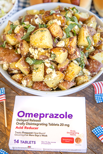 grilled potato salad in a bowl with a box of omeprazole