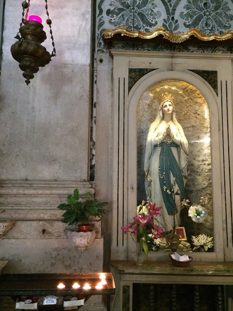 Madonna and Prayer Candles at Church in Venice Italy