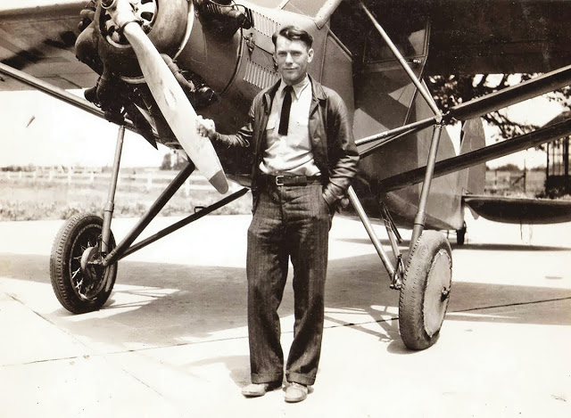"Douglas ""Wrong Way"" Corrigan, famous for 'accidentally' flying to Ireland instead of California, stands next to his rebuild airplane described as a 'rattletrap'. c. 1935. Wrong Way and other stories of pilots. marchmatron.com"