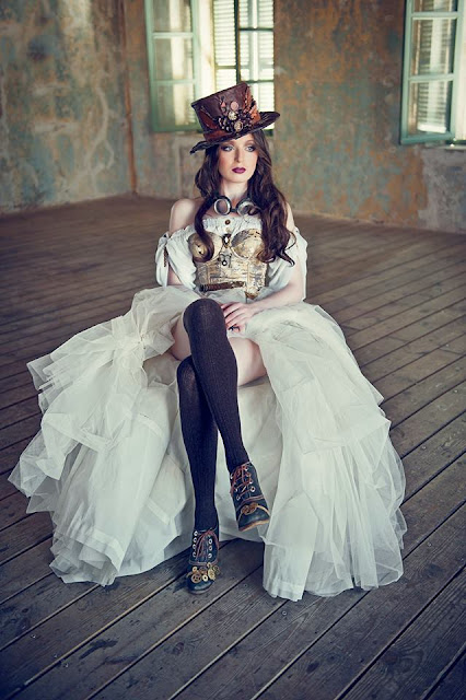 womens steampunk clothing for wedding or costumes. Wedding dress, top hat, goggles, corset, stockings and boots.