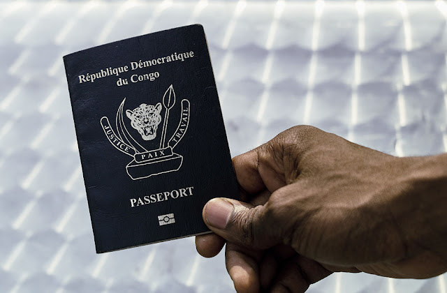 Image Attribute: An immigration official displays a Congolese biometric passport in the Democratic Republic of Congo's capital Kinshasa, February 10, 2017.  Picture taken February 10, 2017. REUTERS/Stringer