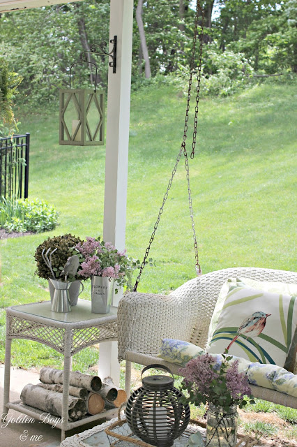 Covered patio ideas with wicker porch swing - www.goldenboysandme.com