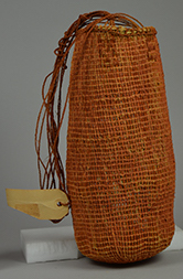 Woven bag made from pandanus leaves painted with ochre colour