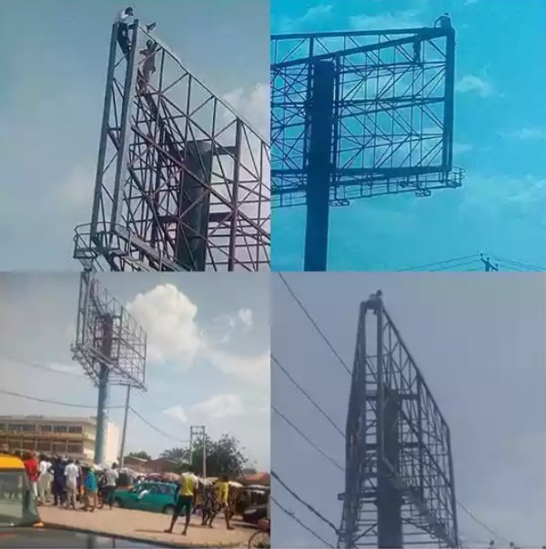 Man Climbs Billboard Over Nigeria Hardship, Vows To Tumble If Buhari Fail To Resign Within 12 Hours