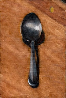 Oil painting of a desert spoon on a chopping board.