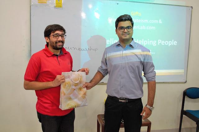 Syed Faizan Ali Giving away Templateism Goodies to Winner
