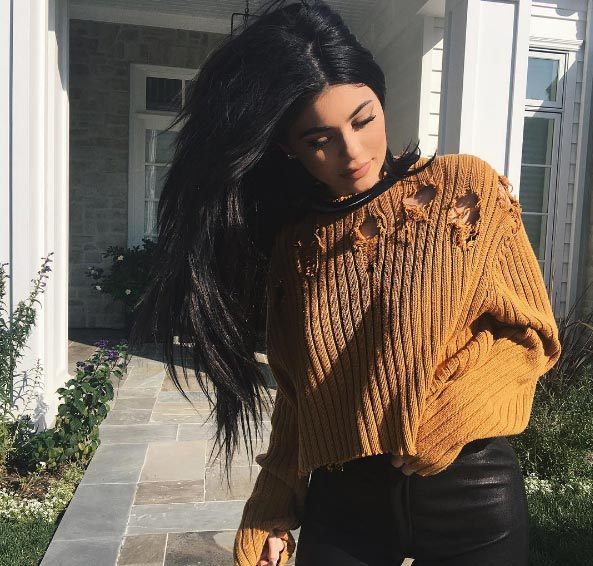 Kylie Jenner flashes belly in Yeezy sweaters