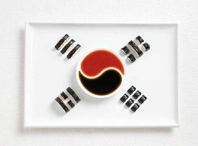South korean flag made out of food Kimbap and Sauces
