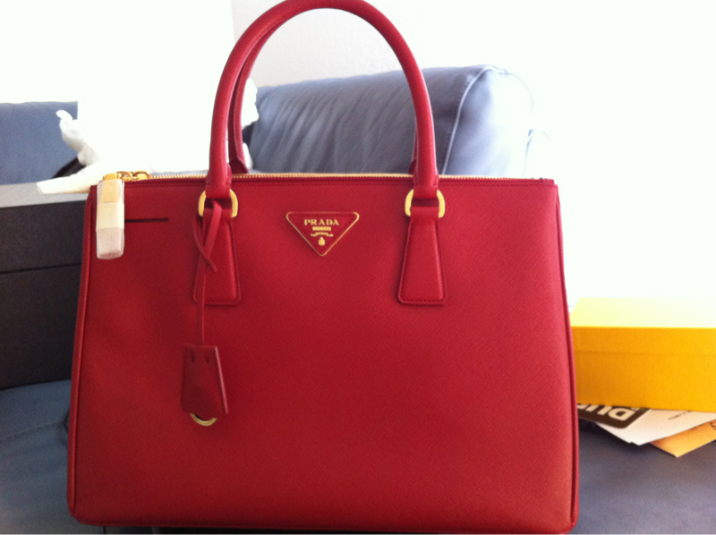 4def54e172a6 ... official the prada saffiano lux tote comes in various sizes so you may  have to consider ...