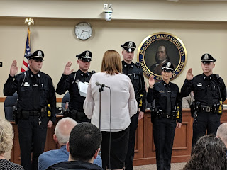 five new police officers sworn in by Town Clerk Teresa Burr