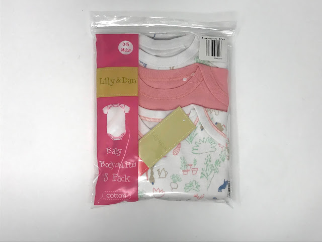A 3 pack of Lily & Dan Aldi Baby Bodysuits
