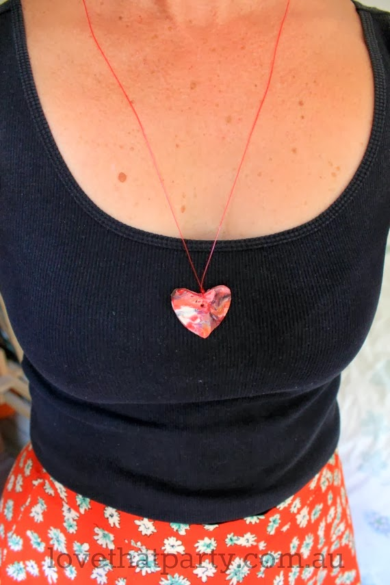 Kid's Valentine's Craft: Heart Pendant. Easy craft activity for your kids to make using something most households have! www.lovethatparty.com.au