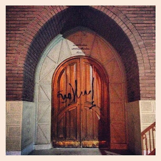 graffiti on church's doors