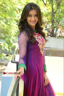 Actress Pooja Jhaveri Latest Stills in Purple Salwar Kameezt at Dwaraka Success Meet  0138.JPG