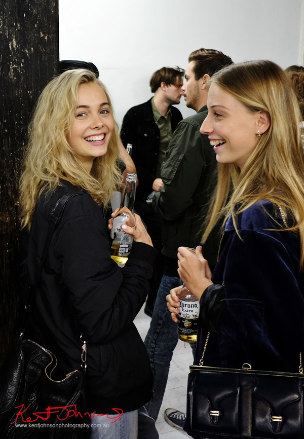 Beautiful young women wearing all black outfits drinking Corona beer at China Heights gallery. Photo by Kent Johnson for Street Fashion Sydney.