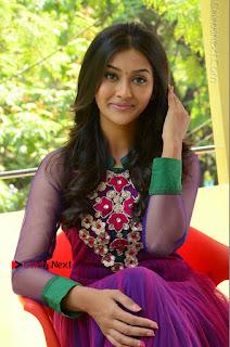 Actress Pooja Jhaveri Latest Stills in Purple Salwar Kameezt at Dwaraka Success Meet  0207.JPG