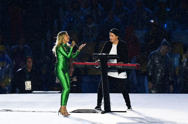 "Norwegian DJ Kygo, who released his debut album in May, and singer-songwriter Julia Michaels, rocking a vibrant green jumpsuit, performed ""Carry Me"" as a light rain fell."