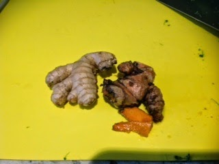 ginger and turmeric on cutting board