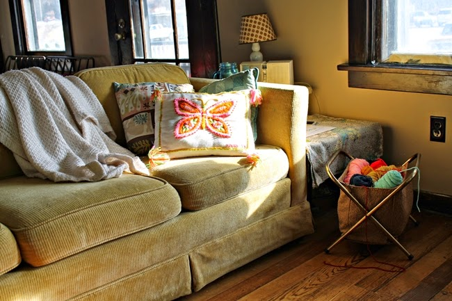 retro living room at va voom vintage yarn basket, vintage yellow sofa, throw pillows and radio