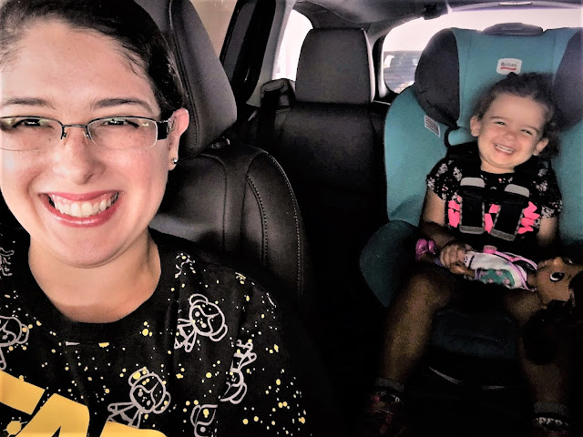 Me in the front seat, three-year-old in the backseat. We're all smiles.