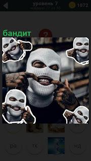 Человек в маске с наколками на руках, настоящий бандит