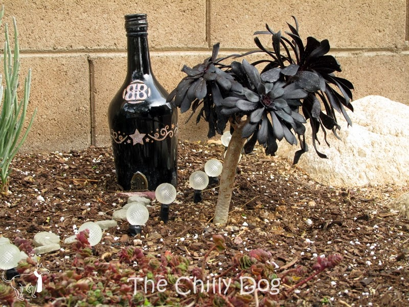 Fairy Garden: Create a fairy house with a re-purposed glass bottle