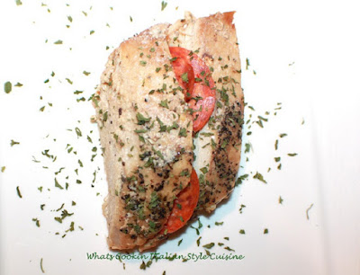 this is a recipe for stuffed pork tenderloin with tomato and mozzarella with basil