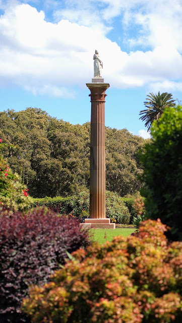 Column with a statue on top at the Rose and Column Garden in Centennial Park in Sydney Australia