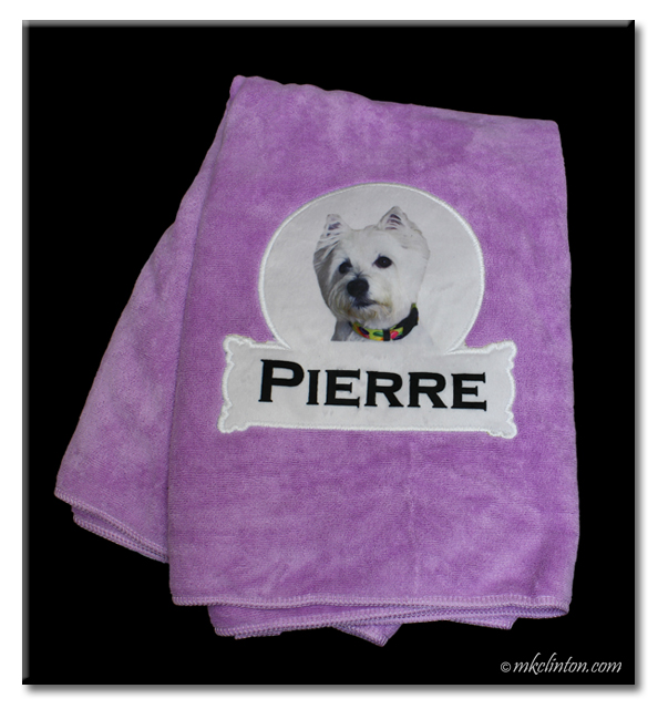 purple towel from PrideBites with a Westie and the name Pierre on it