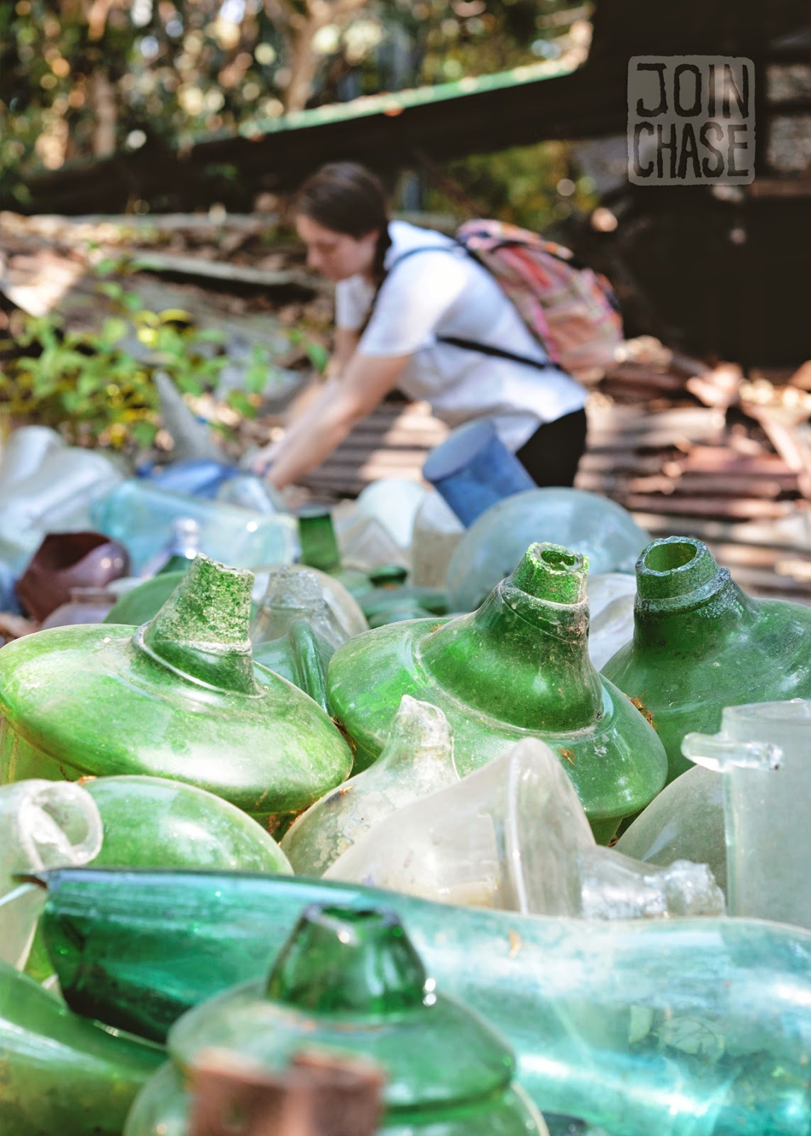 A visitor looking for old glass items around Nagar Glass Factory in Yangon, Myanmar.