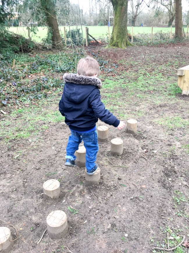 boy-walking-on-stepping-stones