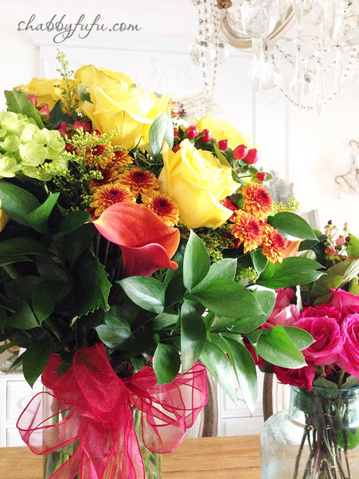 Thanksgiving Beach House decor - fall flower arrangements with pink, yellow, and orange flowers