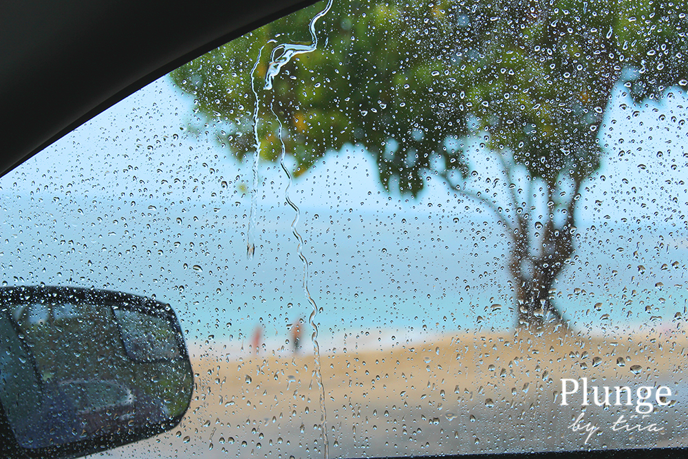 Sitting in a car and waiting for a rain to pass. Oahu, Hawaii.