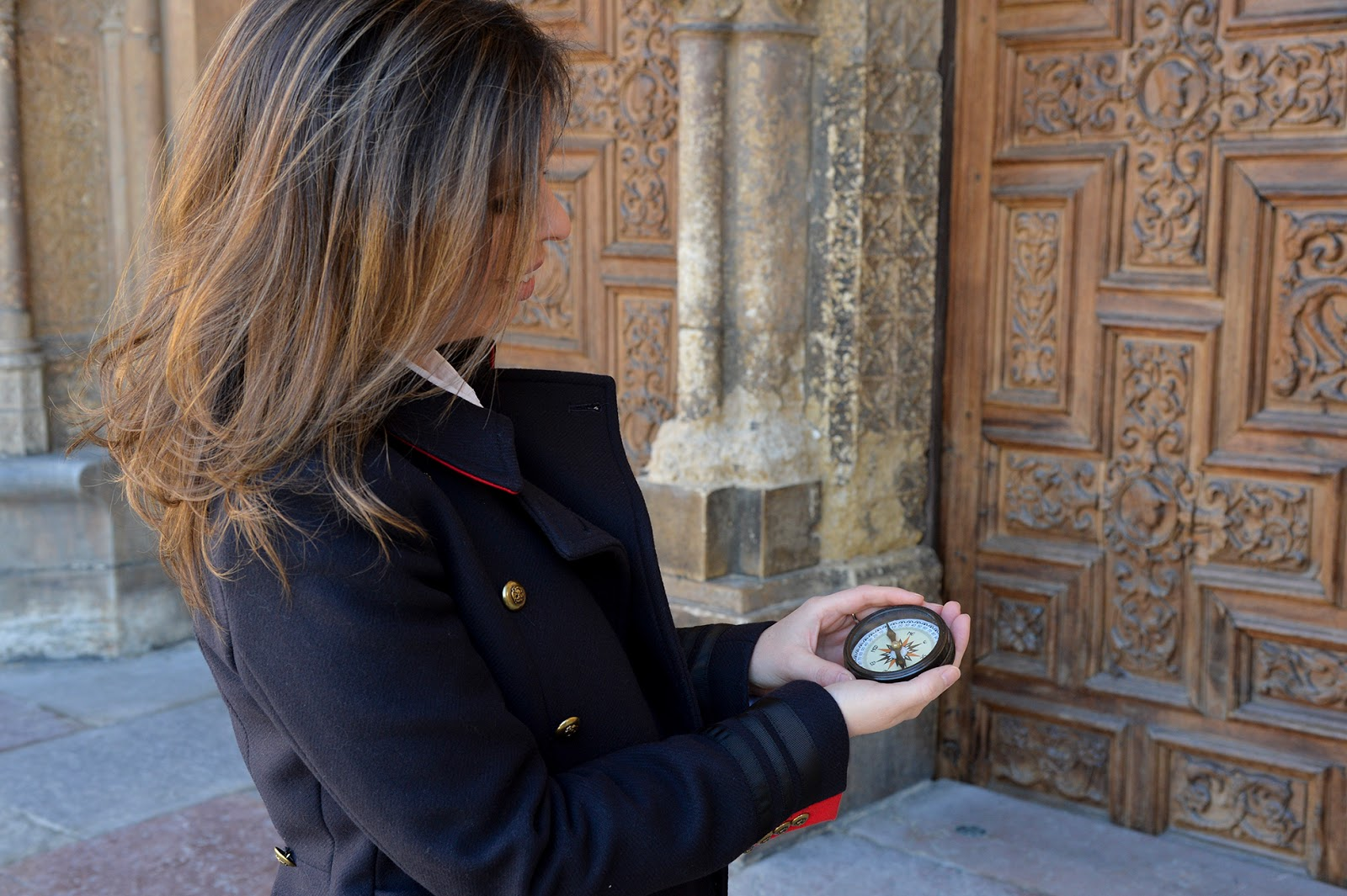 girl traveling solo compass