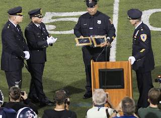 Police Ceremony At High School Football Game Causes Outrage Among Black Groups