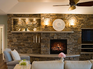 large stoned fireplace plus white lighting and cream sofas feats brown fan idea