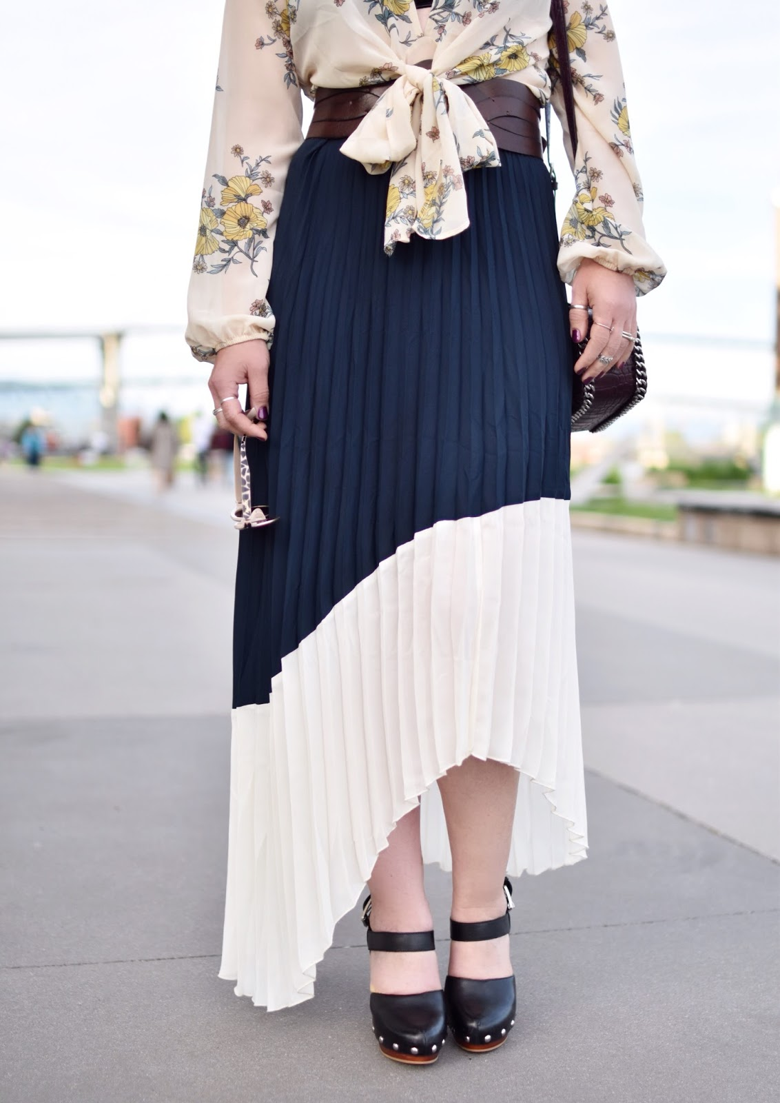 Monika Faulkner outfit inspiration - pleated maxi skirt, floral bow-front blouse, corset belt, and platform mary-jane shoes