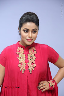 Actress Poorna Latest Stills in Red Dress at Rakshasi First Look Launch  0173.JPG